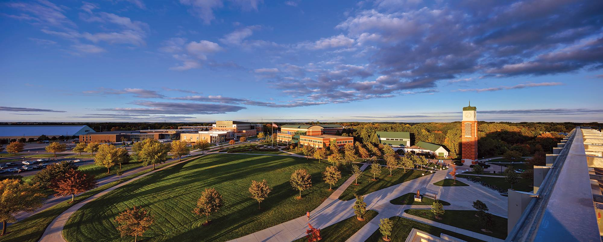 An image from the cover page of the 2019 Grand Valley accountability report. The photo features a photo of the clock tower area from the raised vantage point of the roof of the Mary Idema Pew Library.
